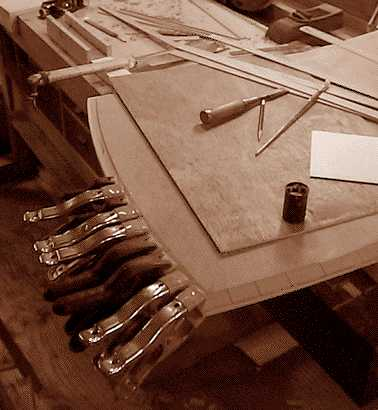 Image showing the process of applying the edging of this pearwood writing desk